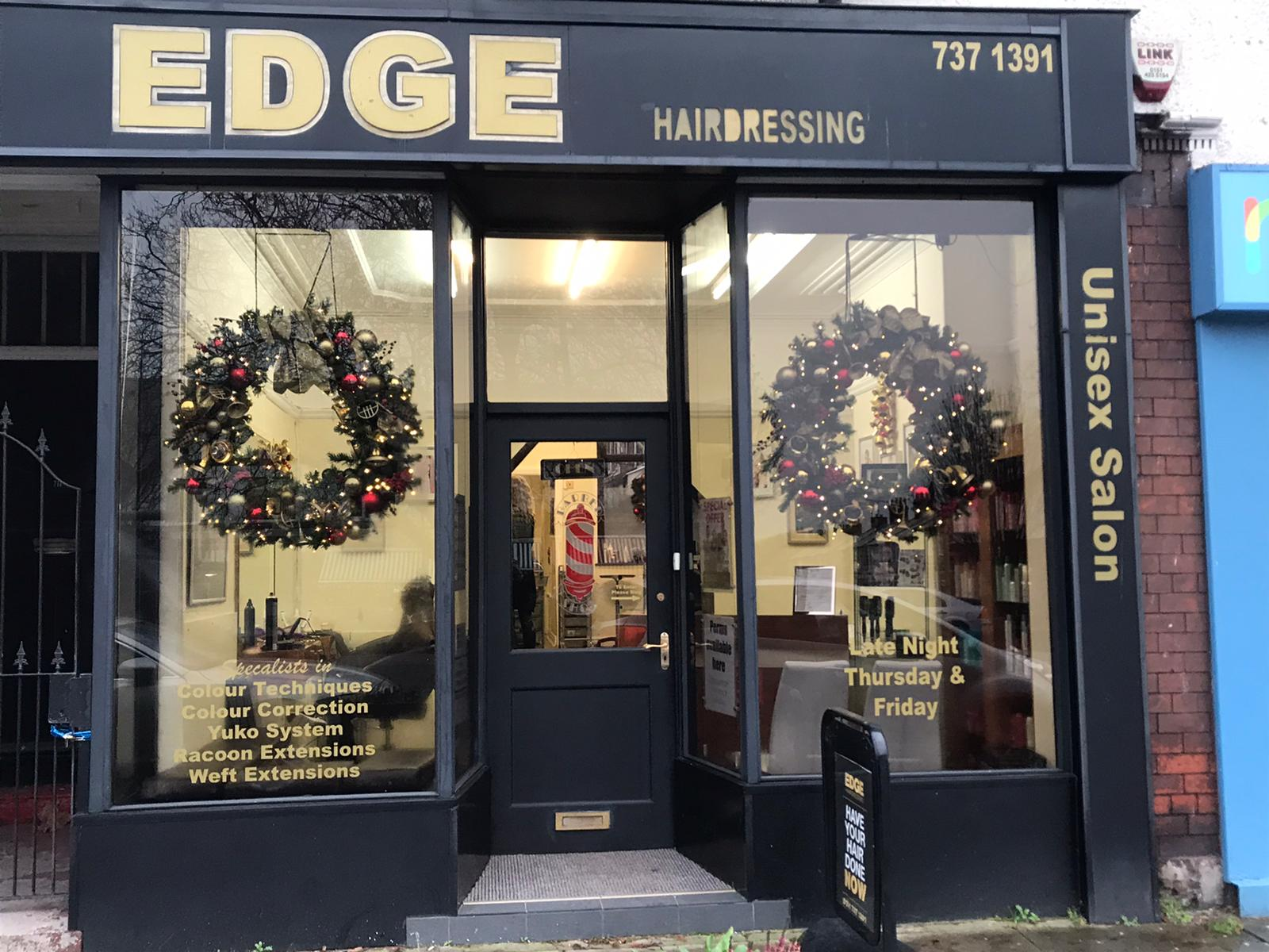 The Edge Hair Salon on Allerton Road, Mossley Hill with Cristmas decorations in the window : 2019
